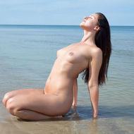 Naked Natural Teen Posing At The Beach-08