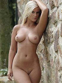 Busty Miela posing naked outdoors