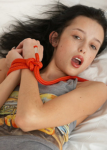 black haired young chick tied hands