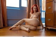 Naked redhead babe Ariel showing her curvy body-10
